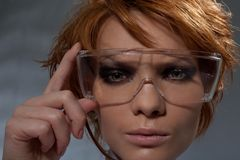 Portrait of suspicious woman in scientist glasses Stock Images