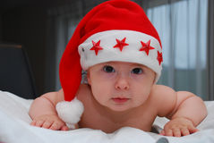 Portrait of sweet baby in christmas hat Royalty Free Stock Photos