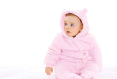 Portrait of sweet baby in soft overalls looking away Royalty Free Stock Photos