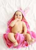 Portrait of sweet baby in towel lying on the bed at home Royalty Free Stock Photography