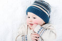 Portrait of a sweet baby in a warm knitted hat and sweater Stock Photography