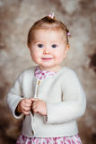 Portrait of sweet blond little girl with big grey eyes Stock Image