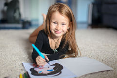 Portrait of a sweet charming young girl who draws Stock Image
