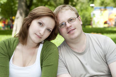 Portrait of a sweet couple in love. A portrait of a sweet couple in love. Sitting outdoors enjoying the spring and each others company Royalty Free Stock Photos