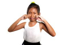 Portrait of sweet and cute female child 8 or 9 years old crying sad in pain feeling unhappy and upset isolated on white background. In bullying victim kid stock photos
