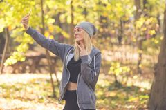 A portrait of a sweet excited girlfriend who makes selfi, has a royalty free stock photography