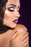 Portrait of sweet female with purple make up and healthy skin Royalty Free Stock Photography