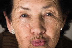 Portrait of sweet grandmother sending a kiss Stock Photos