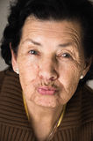 Portrait of sweet grandmother sending a kiss Royalty Free Stock Images