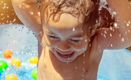Sweet baby boy in the pool royalty free stock images