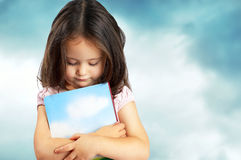 Portrait of a sweet little girl with a book Royalty Free Stock Image