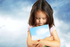 Portrait of a sweet little girl with a book Royalty Free Stock Images