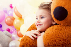 Portrait of sweet little girl hugging teddy bear Stock Photos
