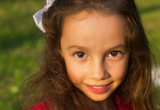 Portrait of Sweet little girl outdoors with curly hair Stock Image