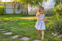 Portrait of sweet little girl play outdoors Stock Photos