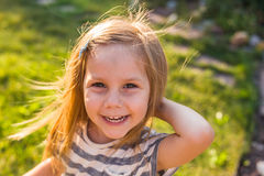 Portrait of sweet little girl play outdoors Royalty Free Stock Images