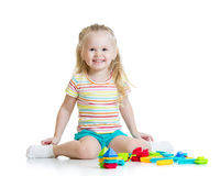 Portrait of sweet little girl with toy blocks Royalty Free Stock Photo