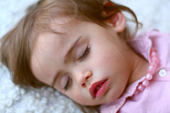 Portrait of sweet 2 year old girl sleeping Royalty Free Stock Photos