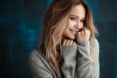 Portrait of sweet young blonde woman in artistic mood, fashion and beauty, casual style. Simple background royalty free stock photos