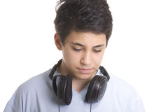 Portrait of a sweet young boy listening to music Royalty Free Stock Photography