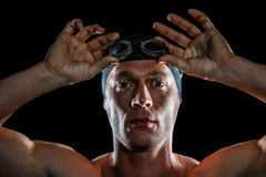 Portrait of swimmer wearing swimming goggles. On black background royalty free stock image