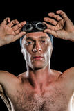 Portrait of swimmer wearing swimming goggles. On black background stock images