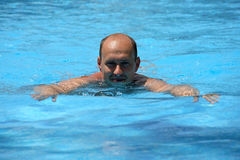 Portrait of swimming man. On water Royalty Free Stock Photo