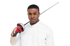 Portrait of swordsman holding sword. On white background Stock Photography
