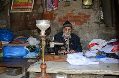 Portrait of a Tailor in the Famous Food Street, Lahore, Pakistan. Portrait of an old Tailor working hard in the Famous Food Street of Lahore, Pakistan Royalty Free Stock Photography