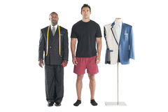 Portrait of tailor standing with customer over white background Royalty Free Stock Images