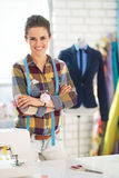 Portrait of tailor woman in front of mannequin Royalty Free Stock Image