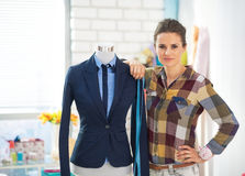 Portrait of tailor woman near mannequin Royalty Free Stock Image