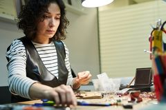 Woman Creating Jewelry stock images