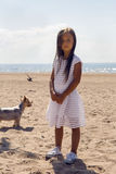Portrait of a tanned girl on the sandy beach Royalty Free Stock Images
