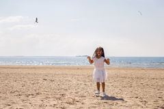 Portrait of a tanned girl on the sandy beach Stock Photography