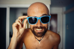 Portrait of a tanned guy in a hotel. In sunglasses Stock Images