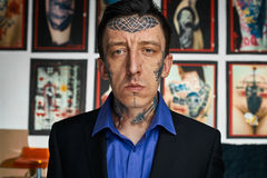 Portrait of tattoo master in black jacked and shirt Stock Photography