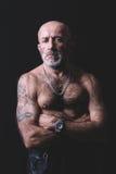 Portrait of tattooed man. Portrait of bald and tattooed man in low key Stock Photo