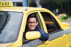 Portrait taxi driver smile car driving happy. Portrait of happy chinese taxi driver in yellow car smiling and looking at camera stock image
