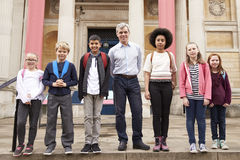 Portrait Of Teacher With Class Standing Outside Museum Royalty Free Stock Photo