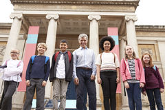 Portrait Of Teacher With Class Standing Outside Museum Stock Photography