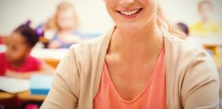 Portrait of teacher in classroom Royalty Free Stock Photo