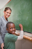 Portrait of a teacher explaining mathematics to a pupil Stock Images