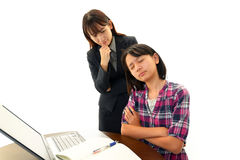 Portrait of teacher with girl  looking uneasy. Stock Photos