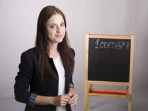 Portrait of the teacher in a great mood and Board in the background Stock Photography