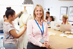 Portrait Of Teacher Helping College Fashion Students Royalty Free Stock Photo