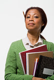 Portrait of teacher holding books Royalty Free Stock Photos
