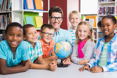 Portrait of teacher and kids with globle Royalty Free Stock Image