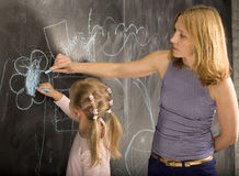 Portrait of teacher with pupil at blackboard Stock Photos