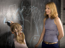 Portrait of teacher with pupil at blackboard Royalty Free Stock Images